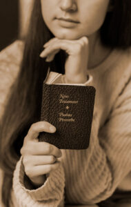 woman reading the new testament of the bible